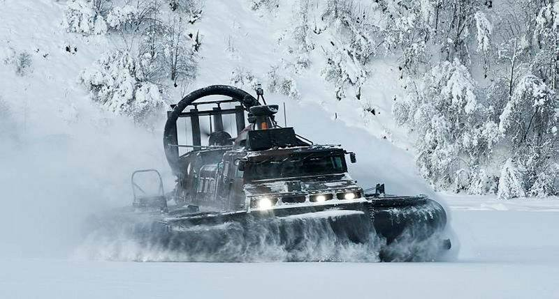 Royal Marines operating a hovercraft during cold weather warfare training
