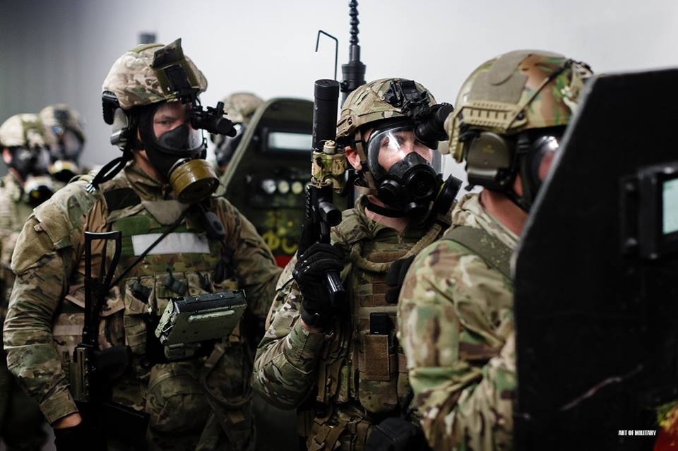 Russian Spetsnaz Alfa team prepare for breaching at the international competition in practical shooting, on the 40th anniversary of the Alfa SF unit creation. July 2014,